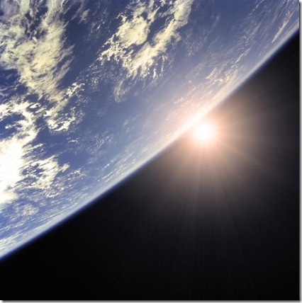 sun-peaking-around-earth