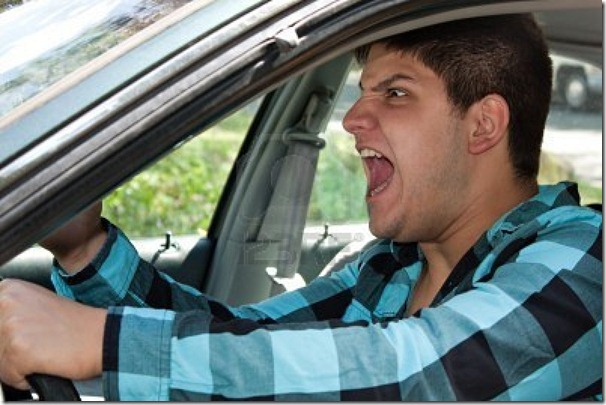 8053431-an-irritated-young-man-driving-a-vehicle-is-expressing-his-road-rage