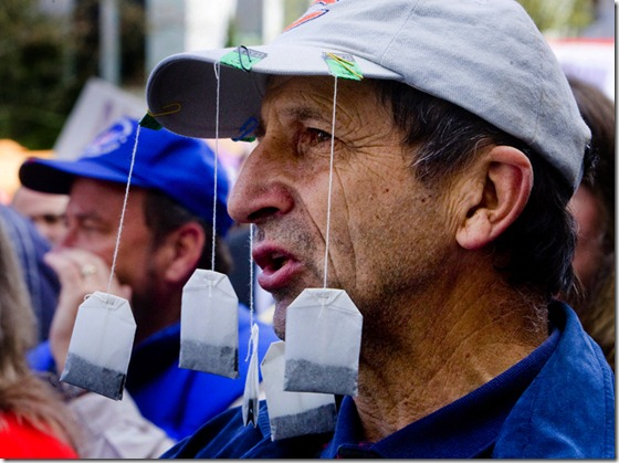 Thousands turn out at the State Capitol to rally against Obama policies, huge deficits, bigger government and higher taxes.  Corneliu Constantinescu (CQ) wears tea bags on his hat at the rally on the steps of the Capitol.  Photo by Doug Beghtel/ The Oregonian
