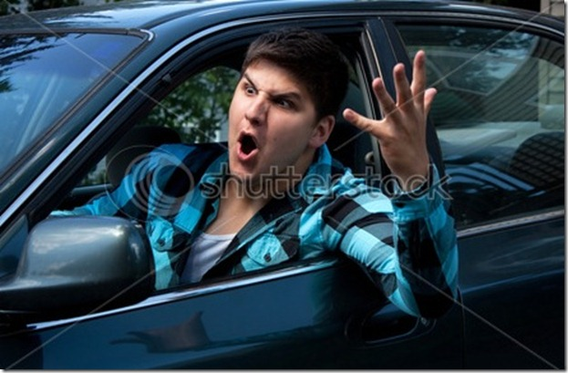 irritated-young-man-driving-a-vehicle-is-expressing-his-road-rage